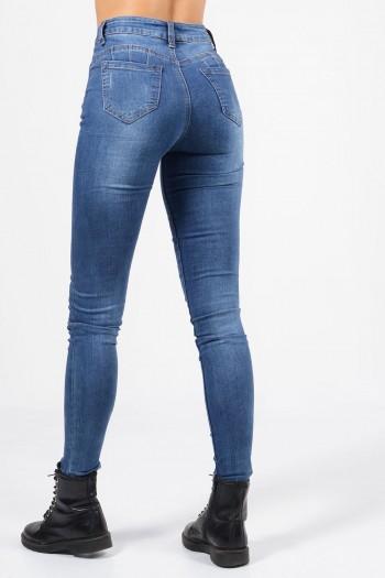 Τζιν παντελόνι με τσέπες και skinny εφαρμογή. Ψηλόμεσο, με φθορές και διακοσμητικές ραφές.