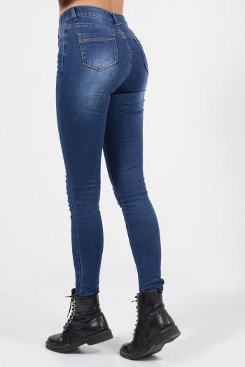 Γυναικείο τζιν παντελόνι με skinny εφαρμογή, μεσαίο ύψος μέσης και ξεβαμμένες λεπτομέρειες.