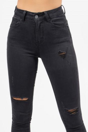 Γυναικείο ψηλόμεσο τζιν παντελόνι σε γκρι χρώμα με σκισίματα και φθορές, με skinny εφαρμογή.